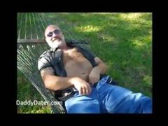 bushy dad bear stroking on a sunny day