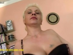 naughty housewife playing with her glass sex-toy