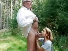 youthful girl helping an old dude wi...