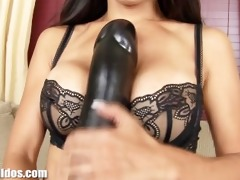 busty asian playgirl riding a brutal brown dildo