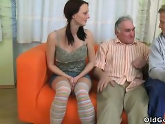 young honey screams out as an old guy gives her a
